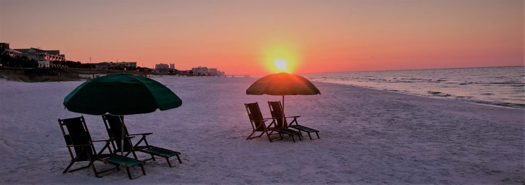 beach sunrise with chairs and umbrellas